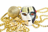 Golden holiday mask with decorations — Stock Photo