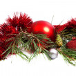 Christmas holiday composition with red ball and tinsel — Stock Photo