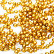 Golden beads new year decoration — Stock Photo