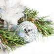 Fir tree branch with Christmas ball and shiny tinsel — Stock Photo #14696313