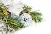 Fir tree branch with Christmas ball and shiny tinsel — Stock Photo