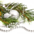 Green spruce twig with Christmas balls and decoration — Stock Photo