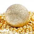 Golden Christmas decoration ball among golden beads — Stock Photo