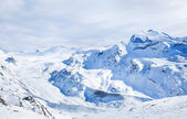 Winter blue and white landscape on Switzerland hills in February — Stock Photo
