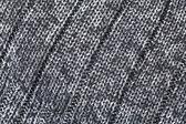 Wełniane dzianiny tło w czerni i bieli zamknij widok — Zdjęcie stockowe