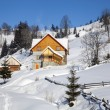 Wooden chalet in winter Carpathian mountains — Stock Photo