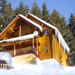 Wooden chalet in winter mountain in Carpathians - Stock Photo