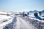 Winter road in snow — Stok fotoğraf
