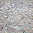 Grey cobblestone boulevard background texture — Stock Photo