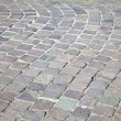 Stock Photo: Grey cobblestone boulevard background texture