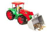 Red and green bulldozer with coins — Stock Photo