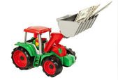Red and green toy bulldozer with dollars  — Stock Photo