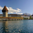 Chapel bridge and the Jesuit church. Lucerne, Switzerland. — Stock Photo