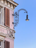 Street lamp on an old building. — Stock Photo