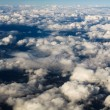 Aerial View of Cloudscape and barren mountains below. — Stock Photo #17212207