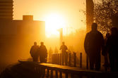 People walking at Port Olimpic in Barcelona at sunset. — Stock Photo