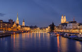 Zurich city center viewed from the river by night — Stock Photo