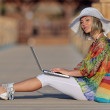 Young woman using laptop outdoor in summer — Stock Photo #10728525