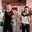 Stock Photo: Young people exercising in gym