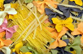 Various uncooked pasta as background — Stock Photo