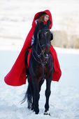 Beautiful woman with red cloak with horse outdoor — Stock Photo