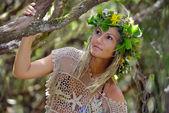 Young woman portrait wearing wreath — Stockfoto