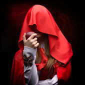 Beautiful woman with red cloak and fruit — Stock Photo