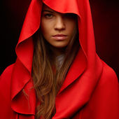 Beautiful woman with red cloak — Stock Photo