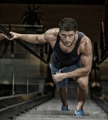 Young man exercising in the gym — Stock Photo