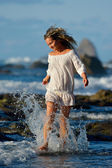 Young caucasian woman refreshing on the beach in summer evening — Stock Photo