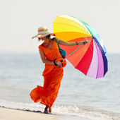 Young woman on the beach in summer — Stock Photo