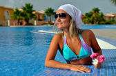 Young woman relaxing at the pool — Stock Photo
