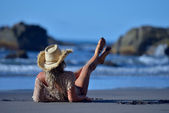 Young woman relaxing on the beach in summer — Stock Photo
