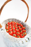 Tomatoes in basket — Stock Photo