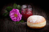 Fresh baked donut and red fruit jam — Stock Photo