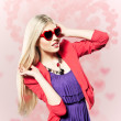 Royalty-Free Stock Photo: Valentine\'s day portrait of an attractive young blonde girl with heart shaped glasses