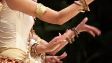 Close up of traditional Khmer Cambodian female dancers in Apsara dance against black