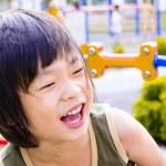 Laughing Asian boy — Stock Photo #9025106