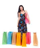 Hermosa chica con bolsas de compras — Foto de Stock