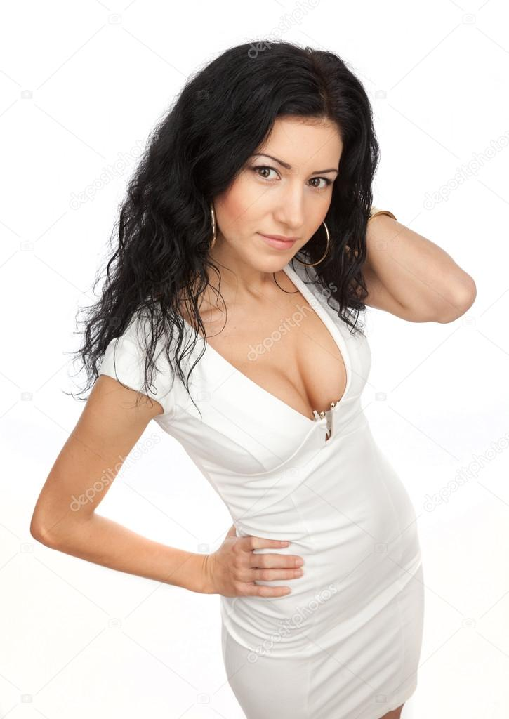 Beautiful brunette with big breasts in a white dress on a white background. — Stock Photo #18712869