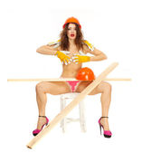 Half-naked beautiful girl in pink panties and orange hard hat on a white background. — Stock Photo