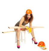 Beautiful girl in pink panties and orange hard hat on a white background. — Stock Photo