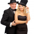 Man and woman in elegant suits and hats — Stock Photo