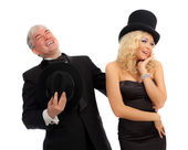Homem e mulher em elegantes ternos e chapéus — Fotografia Stock
