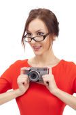 Girl in a red dress with shiny camera — Stock Photo