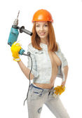 Girl in a helmet and a tool in the hand — Stock Photo