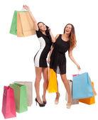 Kadınlar alışveriş torbaları ile — Stok fotoğraf