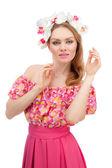 Beautiful girl wearing a wreath of flowers — Stock Photo