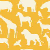 Seamless pattern with african animal silhouettes — Stock Vector