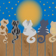 Stockvector : Cats sit on fence. Vector illustration.